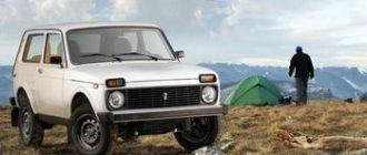 Белая Нива в горах на фоне палатки